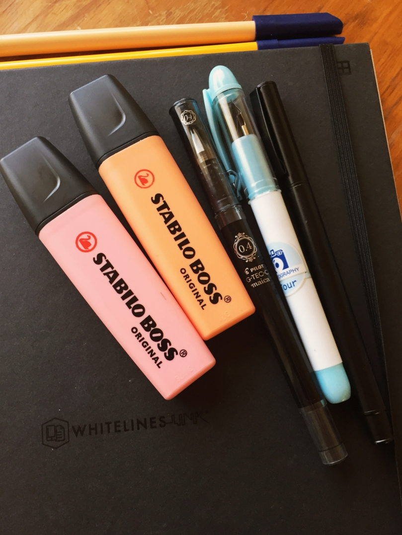 My Whitelines bujo with Stabilo highlighters and various pens.